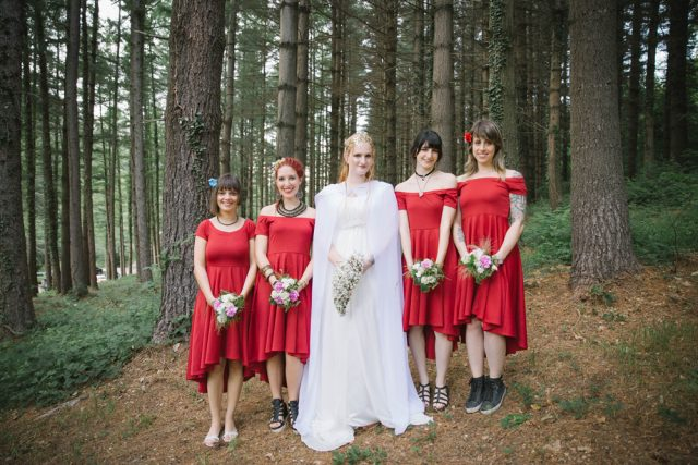 The bridesmaids were wearing red high low dresses with different accessories and shoes