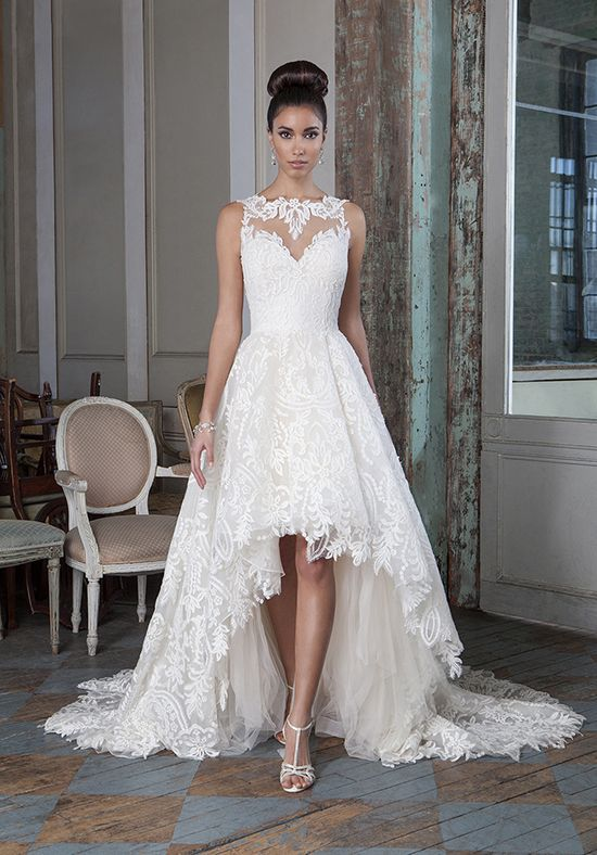 a chic high low sleeveless wedding dress with an illusion sweetheart neckline and a train
