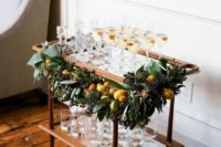03 a decorated champagne cart – greenery and fresh citrus to make it chic