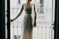 03 a high neckline long sleeve wedding dress with an embroidered and embellished bodice and a plain skirt