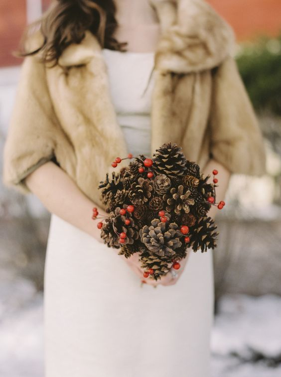a pinecone wedding bouquet with berries can  be easily DIYed and won't wither