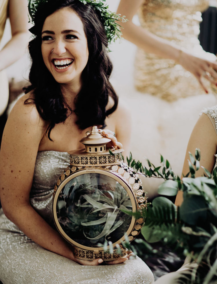 The bridesmaids were carrying unique copper lanterns with air plants inside instead of bouquets