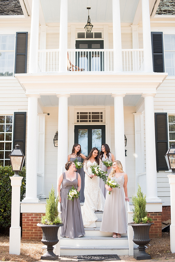 The bridesmaids were wearing maxi gowns in different shades of grey