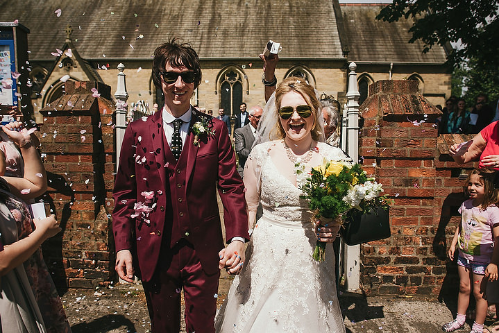 The groom was wearing a 60s inspired burgundy three-piece suit with a printed tie