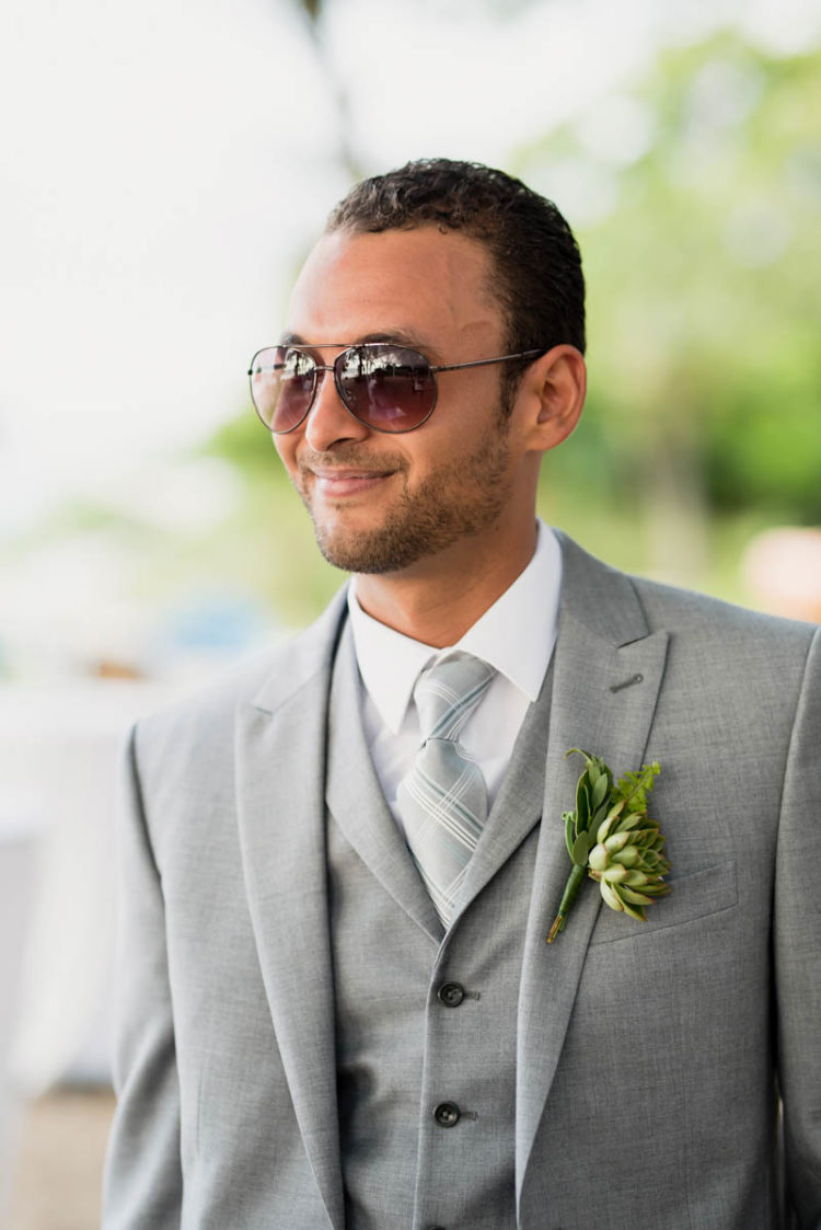 The groom was wearing a light grey three-piece suit and a checked tie