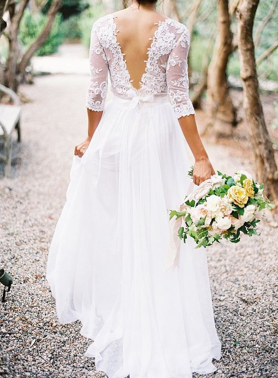 a chic wedding dress with a lace bodice and half sleeves, an ethereal skirt and a V cutout