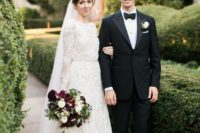 04 a high neckline long sleeve A-line wedding dress of textural lace and with a matching veil
