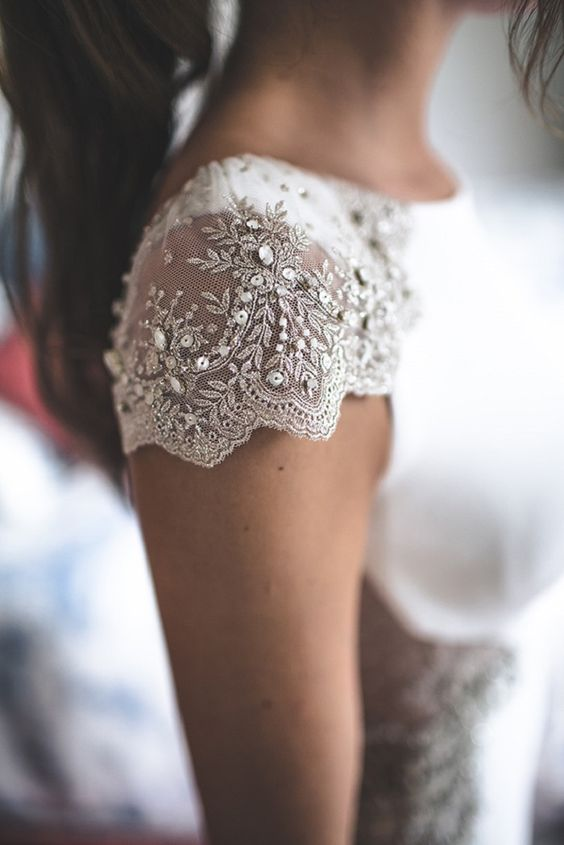 a lace cap sleeve with champagne eombroidery, beading and sequins