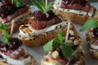 04 cranberry, brie and prosciutto crostini with balsamic glaze is a delicious idea for those who love meat