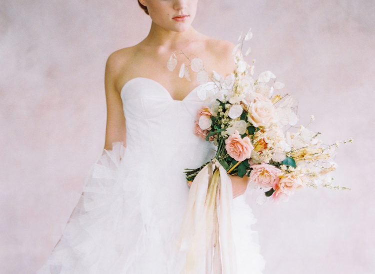 The ethereal bridal bouquet was done with blush roses and some airy touches