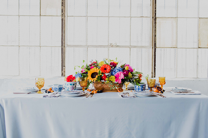 The tablescape was very bold and eclectic, with amber glasses, blue china and a colorful centerpiece