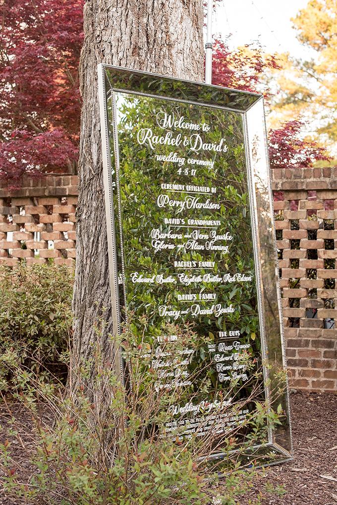 The wedding program was written on an oversized vintage mirror