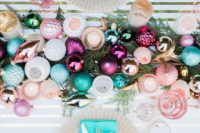 05 a colorful and glitter ornament table runner on fir branches and ornaments for each place setting