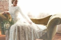 05 a lace applique wedding gown with a bateau neckline and logn sleeves is a timeless option that never goes out of style