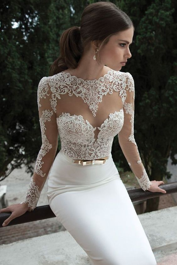 a sheath wedding dress with a lace bodice, an illusion sweetheart neckline, long sleeves and a plain skirt