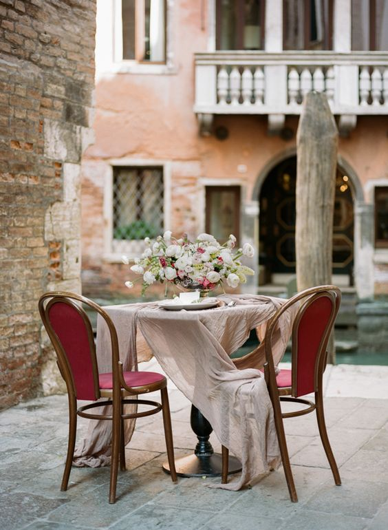 have a romantic dinner right on a porch in Venice to enjoy the looks of the ancient city