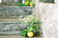 05 lemons and baby's breath in mason jars to line up a wedidng staircase or aisle