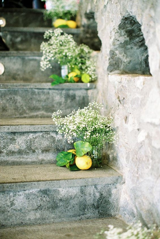 lemons and baby's breath in mason jars to line up a wedidng staircase or aisle