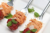 05 spaghetti and meatballs on forks with greenery is a cool way to serve some meat