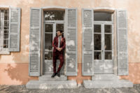 06 The groom was wearing a burgundy wedding suit and black shoes
