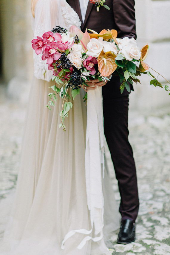 The wedding bouquet was a lush fall one, with pink blooms, berries and cascading foliage