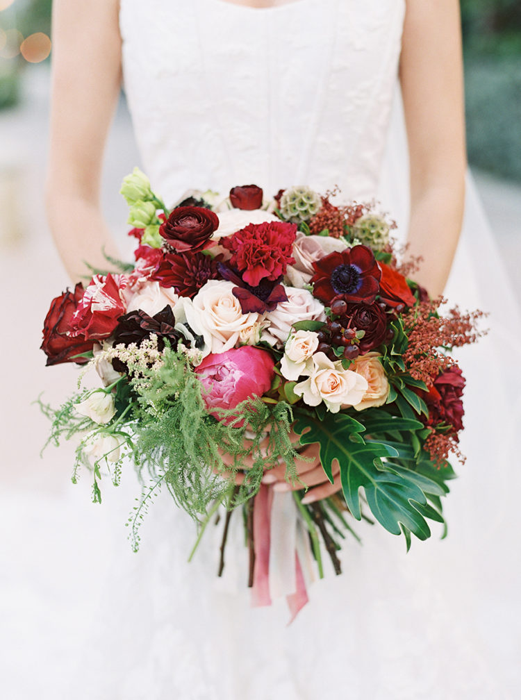 The wedding bouquet was bold - red, pink, blusha and cream and with a tropical twist - some tropical leaves in it