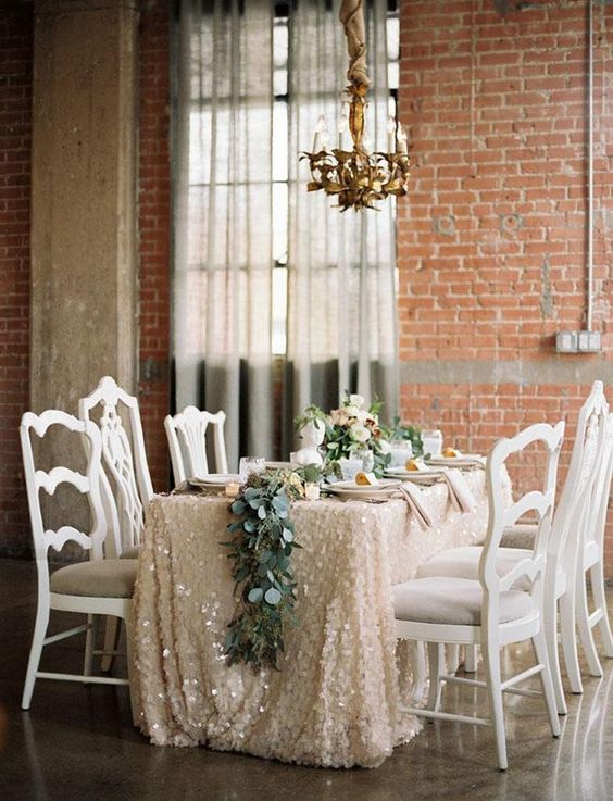 a blush sequined tablecloth, a greenery table runner will be a nice idea for a winter bridal shower