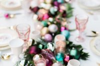 06 a gorgeous table runner made of candle holders, greenery and colorful Christmas ornaments