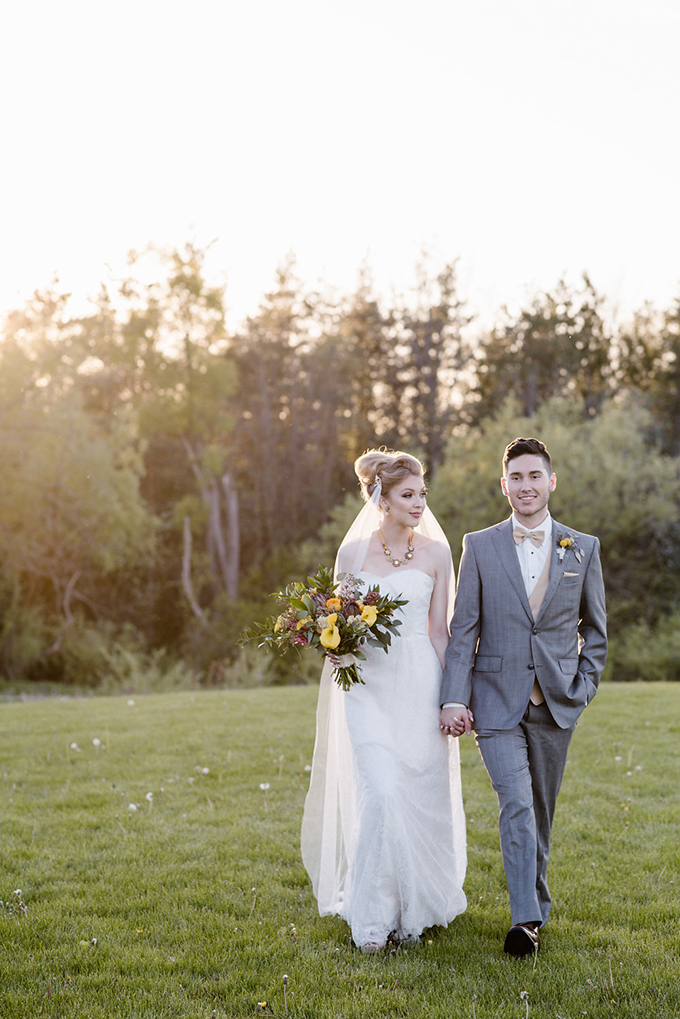 The grey groom's suit was made more eye-catchy with a beige waistcoat and bow tie