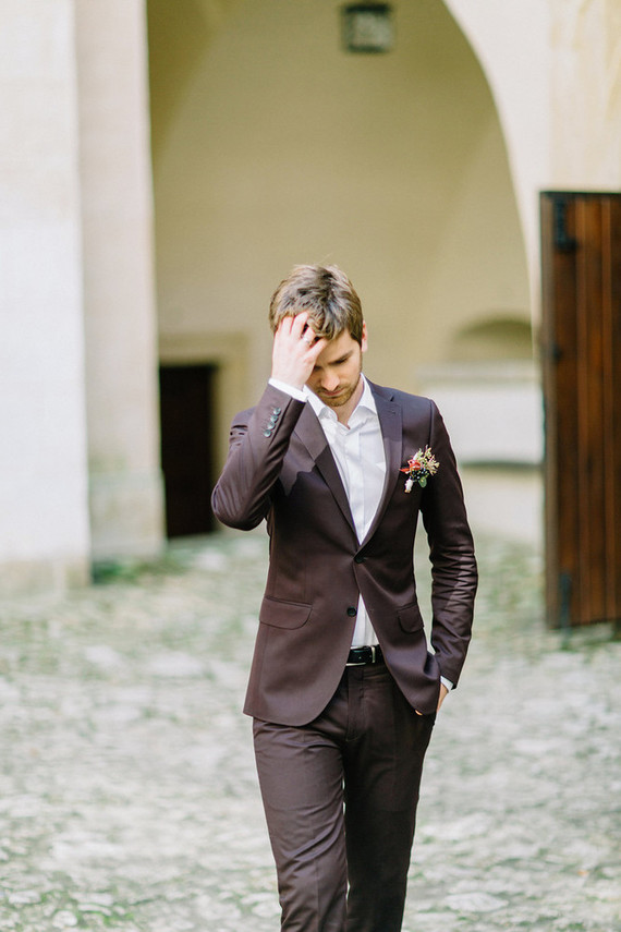 The groom rocked a brown suit with a white shirt and a fall boutonniere