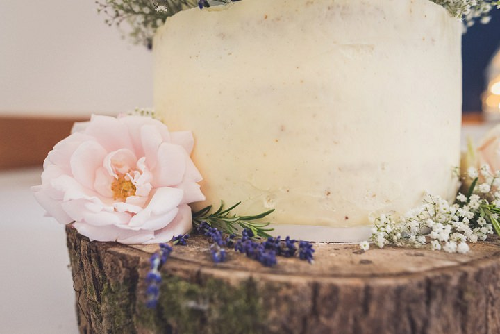 The wedding cake was simply frosted and decorated with fresh flowers
