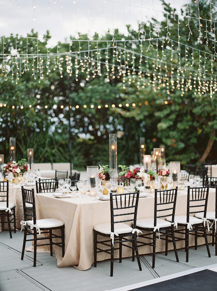 The wedding reception was rather glamorous, with bold blooms, candles and lots of lights