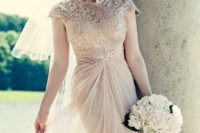 07 a blush wedding gown with draperies, applique bodice, cap sleeves and a matching headpiece