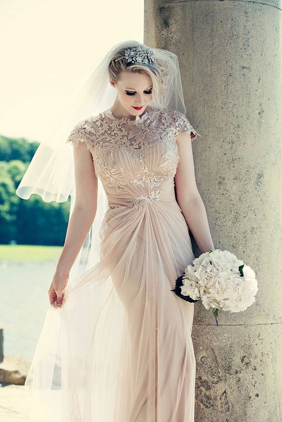 a blush wedding gown with draperies, applique bodice, cap sleeves and a matching headpiece