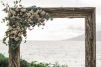 07 an oversized driftwood frame with blush roses and greenery for a coastal wedding