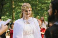 08 The bride was wearing a flowy light dress and a cap, a perfect elvish headpiece and a braided half updo
