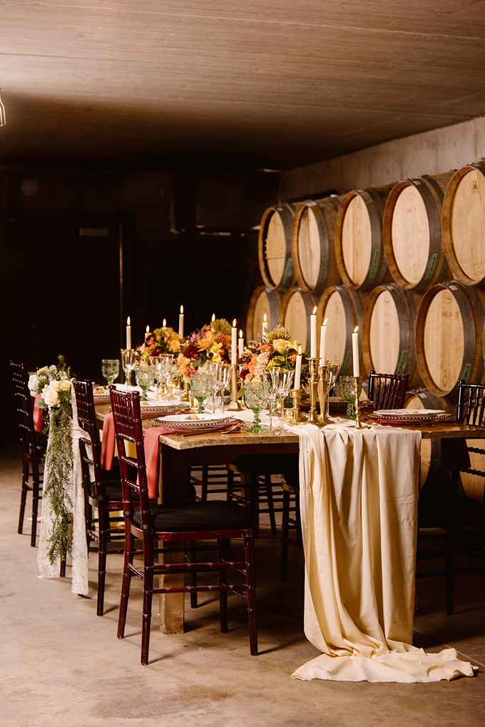 The wedding reception was taken to the cellar, which was lit with candles