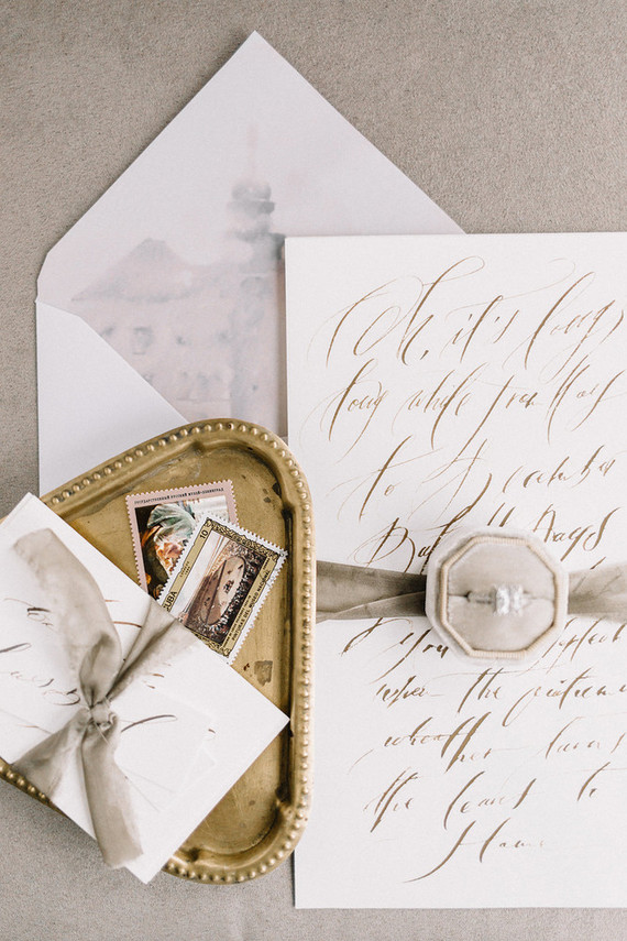 The wedding stationery was done in dove grey and with grey watercolor castle lining