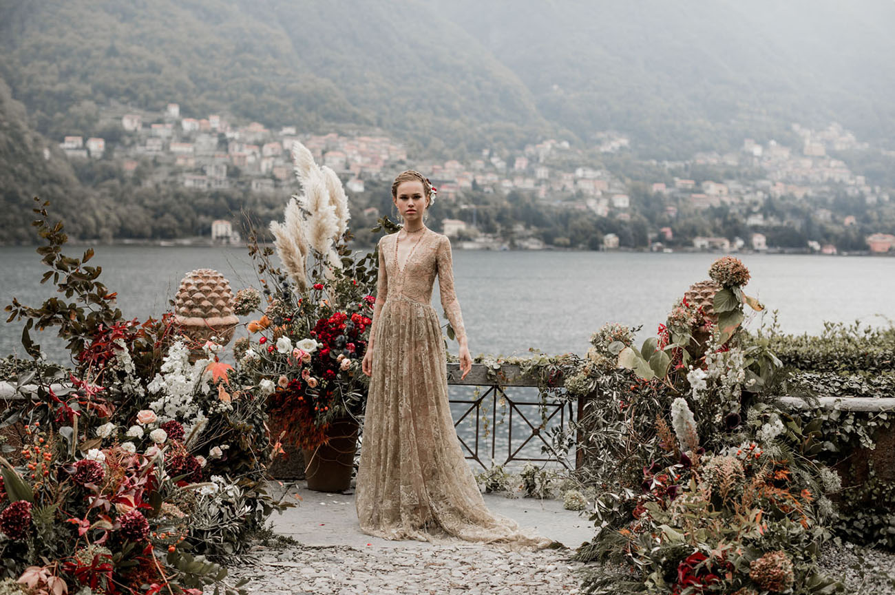 What a gorgeous wedding dress and a lush floral setting