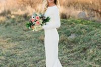 08 a long sleeve mermaid wedding dress with a lace train looks chic and girlish