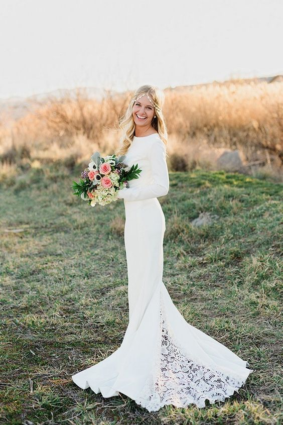 a long sleeve mermaid wedding dress with a lace train looks chic and girlish