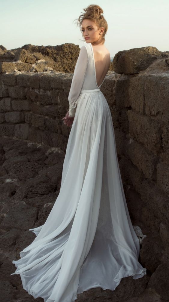 chic plain wedding dress with a fully cutout back, long sleeves and a train
