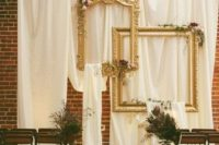 08 draped fabric and vintage refined picture frames for a vintage-inspired wedding