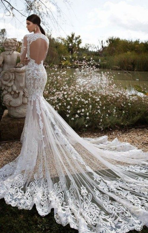 sexy mermaid wedding dress with long sleeves and a long train and a cutout back
