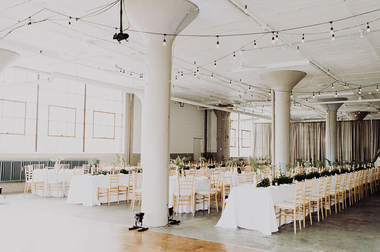 the color palette chosen was white and gold, and foliage refreshed the venue a lot