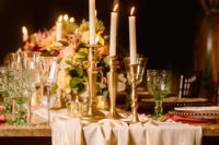09 An airy table runner, gold candle holders and gold rim glasses added a refined touch to the tablescape