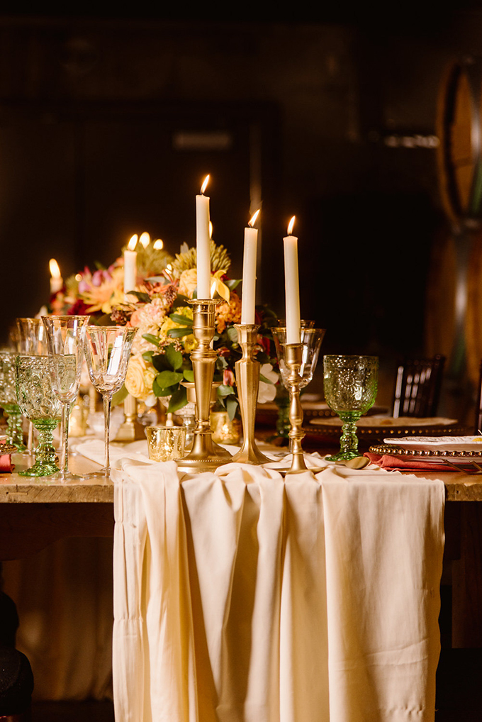 An airy table runner, gold candle holders and gold rim glasses added a refined touch to the tablescape