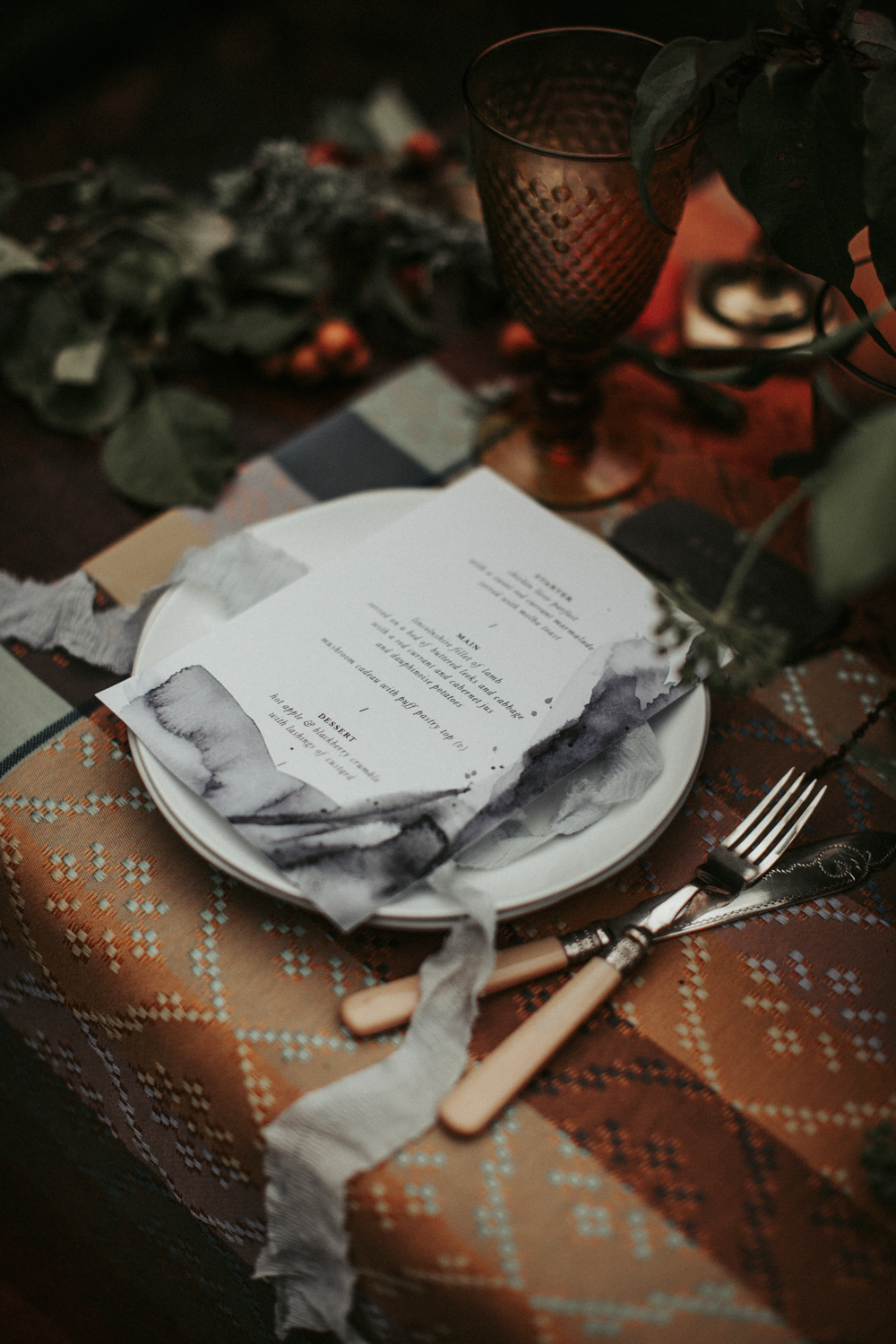 Ombre menus and airy ribbon added chic to the table
