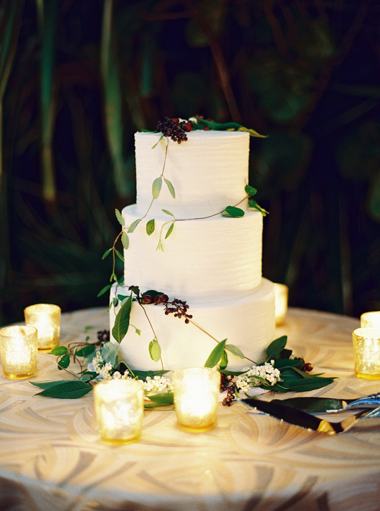 The wedding cake was a textural white one, with fresh greenery and berries and candles around