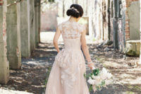 09 a blush wedding dress with cap sleeves, lace appliques and an illusion neckline